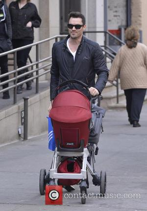 Brian Austin Green and Noah Shannon Green - Brian Austin Green pushes son Noah Shannon Green in a stroller in...