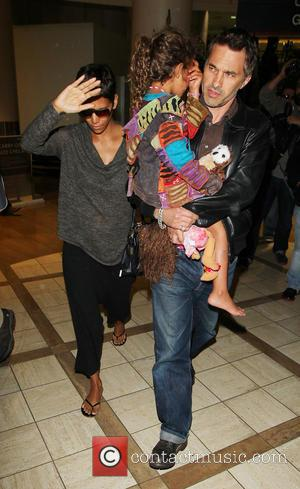 Halle Berry - Halle Berry arrives at LAX airport with...