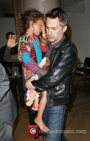 Olivier Martinez and Nahla Aubry - Halle Berry scuffles with photographers as she arrives at LAX airport with her fiance...
