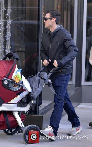 Brian Austin Green - Brian Austin Green walks his baby son Noah into their hotel in Manhattan - New York...