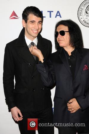 Nick Simmons and Gene Simmons