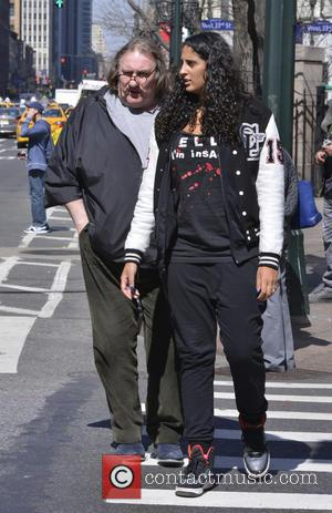 Gerard Depardieu - Gerard Depardieu leaves Kunjip Korean Restaurant in Manhattan with a female companion. Depardieu skipped a court date...