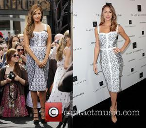 Stacy Keibler and Ashley Tisdale - Ashley Tisdale at The Grove for her appearance on 'Extra' in Los Angeles, California...