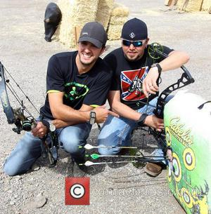 Luke Bryan and Jason Aldean - ACM & Cabela's Great Outdoors Archery Event during the ACM Experience at The Orleans...