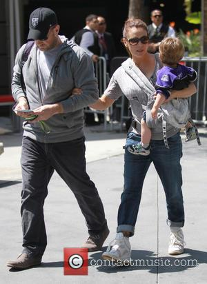 Alyssa Milano, Milo Thomas and David Bugliari - Alyssa Milano carries her son Milo Thomas as she leaves the Los...