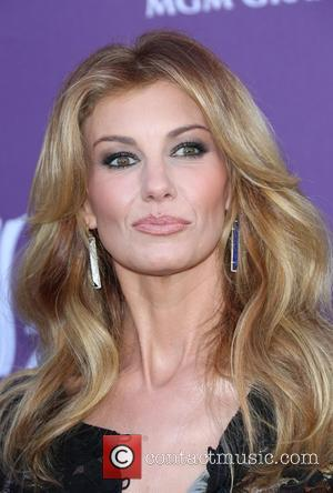 "Faith Hill & Tim McGraw Divorce Rumours Are ""Ridiculous"""