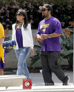 Kimberly Woodruff and Ice Cube aka O'Shea Jackson - Celebrities arrive to watch the Los Angeles Lakers play the Los...