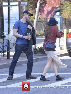 Elizabeth Olsen and Boyd Holbrook - Elizabeth Olsen and boyfriend Boyd Holbrook seen walking together in SoHo - New York...