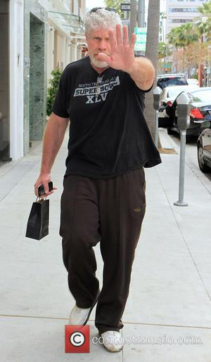 Ron Perlman - Ron Perlman tries to cover his face from photos whilst walking along Brighton Way in Beverly Hills...