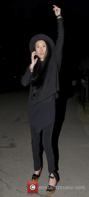 Vera Wang - Fashion designer, Vera Wang talking on her cell phone as she leaves Central Park after attending the...