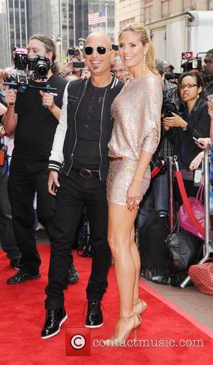 Howie Mandel and Heidi Klum