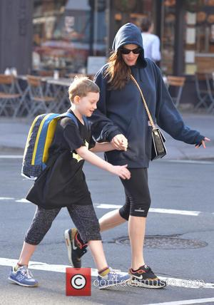 Liv Tyler and Milo William Langdon - Liv Tyler takes her son Milo to school while wearing an oversized sweat...