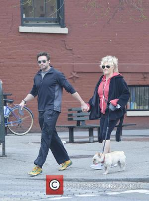 Hugh Jackman - Hugh Jackman and wife Deborra-Lee Furness walk...