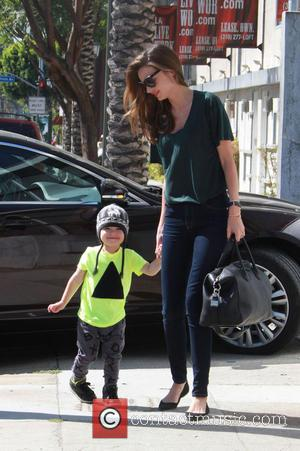 Miranda Kerr and Flynn Christopher Blanchard Copeland Bloom - Miranda Kerr and husband Orlando Bloom with son Flynn leaving a...