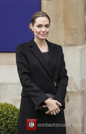 Angelina Jolie - Angelina Jolie and William Hague arrive at...