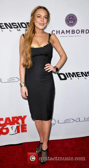 Linday Lohan - Premiere of 'Scary Movie 5' at ArcLight Cinemas Cinerama Dome in Hollywood - Los Angeles, California, United...