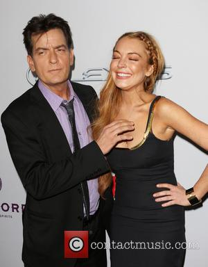 Charlie Sheen and Lindsay Lohan - Premiere of 'Scary Movie 5' at ArcLight Cinemas Cinerama Dome in Hollywood - Hollywood,...