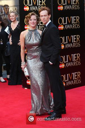 Ed Watson and guest - The Laurence Olivier Awards 2014 held at the Royal Opera House - Arrivals - London,...