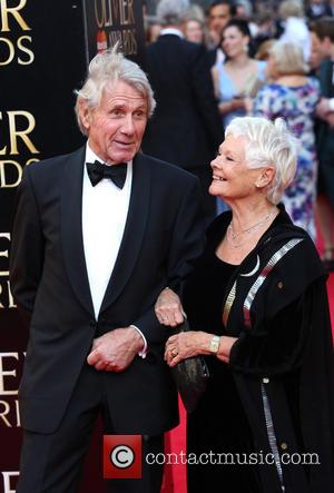 Judi Dench and David Mills - Olivier Awards 2014 held at the Royal Opera House - Arrivals - London, United...