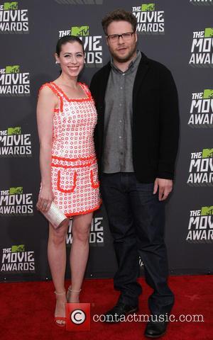 Seth Rogen and Lauren Miller - 2013 MTV Movie Awards held at Sony Pictures Studios- Arrivals - Los Angeles, CA,...