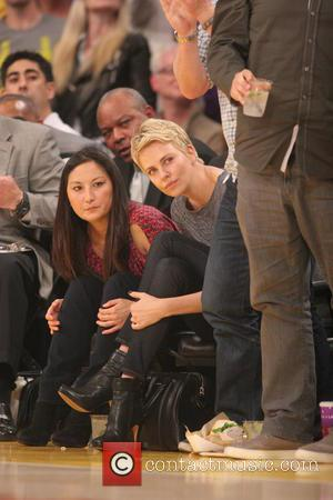 Charlize Theron - Celebrities attend the Los Angeles Lakers vs San Antonio Spurs NBA basketball game. The Lakers beat the...