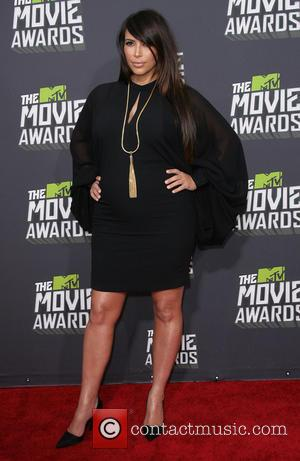 Kim Kardashian Reaches Divorce Settlement With Kris Humphries