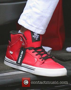 Victoria Beckham and Shoe Supra