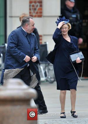Alex Salmond and guest - Guests Leave St Paul's Cathedral in central London, after the funeral of Margaret Thatcher....