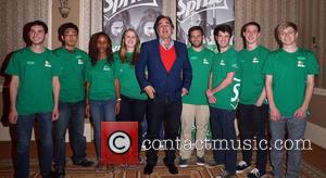 Oliver Stone - Director Oliver Stone meets with student finalists of the 2013 Sprite Films program at Caesars Palace during...