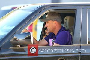 Vinnie Jones and Tanya Jones - Vinnie Jones and his wife Tanya driving along Sunset Boulevard in their black Range...