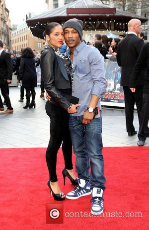 Ashley Walters and Natalie Williams - Iron Man 3 UK premiere held at the Odeon Leicester Square - Arrivals -...