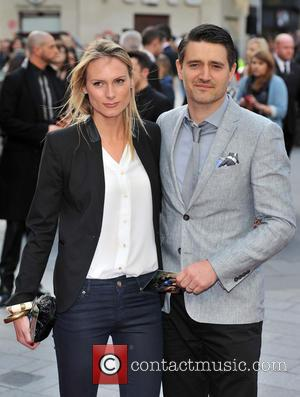Tom Chambers and guest - Iron Man 3 UK premiere held at the Odeon Leicester Square - Arrivals - London,...