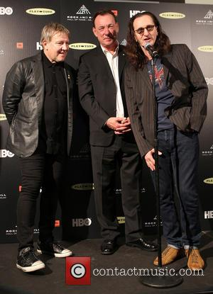 Alex Lifeson, Neil Peart and Geddy Lee - 28th Annual Rock and Roll Hall Of Fame Induction Ceremony - Press...