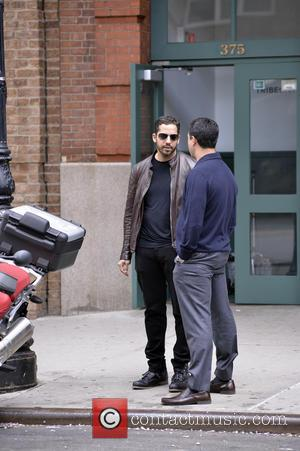 David Blaine - American illusionist David Blaine seen talking with a friend in Manhattan before riding away on his BMW...