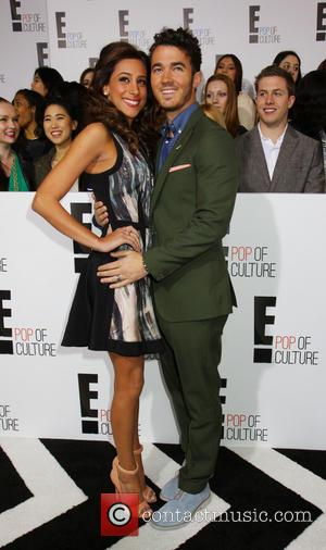 Kevin Jonas and Danielle Jonas - 2013 E Upfront Presentation - Arrivals - New York City, New York , United...