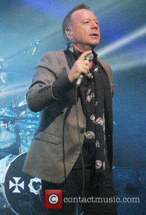 Jim Kerr - Simple Minds performing live in concert on their 'Greatest Hits+ Live Tour 2013' at the Cambridge Corn...