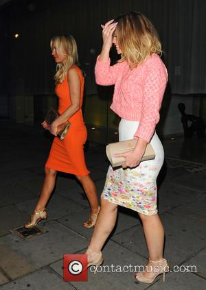 Kimberley Walsh and Denise van Outen - Celebrities leaving Asia de Cuba Restaurant - London, United Kingdom - Wednesday 24th...