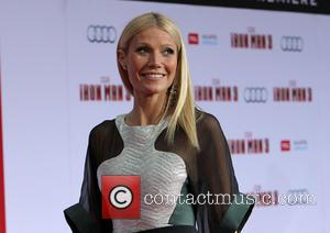 Gwyneth Paltrow Flashes Her Butt At Iron Man Premiere