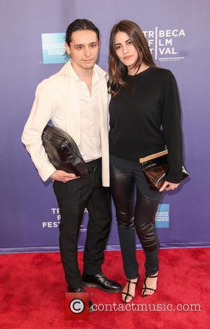 Olivier Theyskens and Luisa Moraes