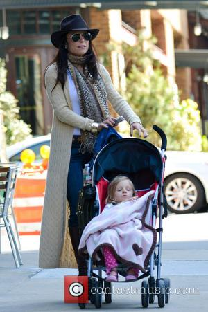 Bethenny Frankel and Bryn Hoppy - Bethenny Frankel shows her daughter Bryn Hoppy her iPhone, which is bejeweled with her...
