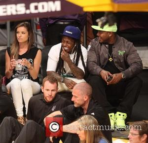 Lil Wayne - Celebrities watch the LA Lakers playoff game at the Staples Center - Los Angeles, California, United States...