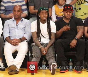 Lil' Wayne, Dwayne Michael Carter and Jr. - Celebrities watch the Los Angeles Lakers play the San Antonio Spurs during...