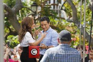 Leah Remini and Mario Lopez - Celebrities at The Grove to appear on entertainment news show 'Extra' - Los Angeles,...