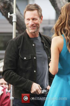 Aaron Eckhart - Celebrities at The Grove to appear on entertainment news show 'Extra' - Los Angeles, California, United States...