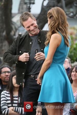 Aaron Eckhart and Maria Menounos - Aaron Eckhart at The Grove for an interview with Mario Lopez for television show...