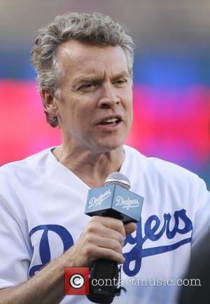 Tate Donovan - Tate Donovan throws the first pitch at the Los Angeles Dodgers vs Colorado Rockies game at Dodger...