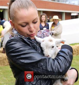 Resident with Lamb - At one point some runner ducks were led into the Fulham Green office and took a...