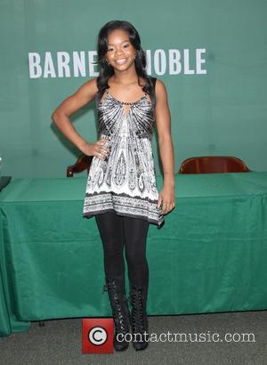 Gabby Douglas - Olympic gold medalist Gabby Douglas signs copies of her new book 'Raising The Bar' at Barnes &...