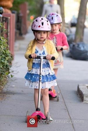 Matthew Broderick, Tabitha Broderick and Marion Broderick - Matthew Broderick takes his twin daughters to school on their scooters -...
