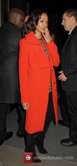 Zoe Saldana, Red Coat, Blow, Kiss and Hand Gesture